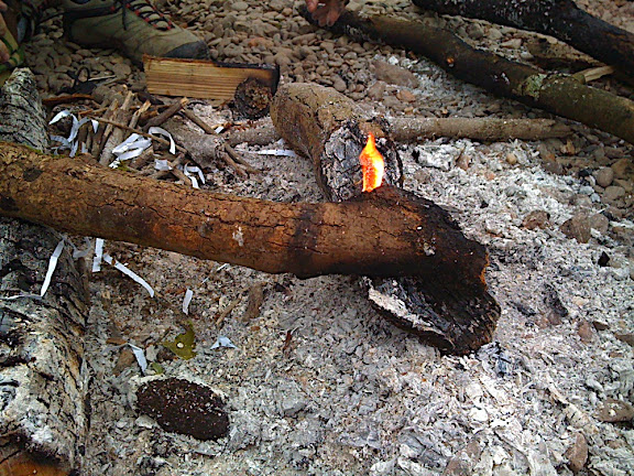 Getting the fire started in the morning, from the pieces of last night campfire...