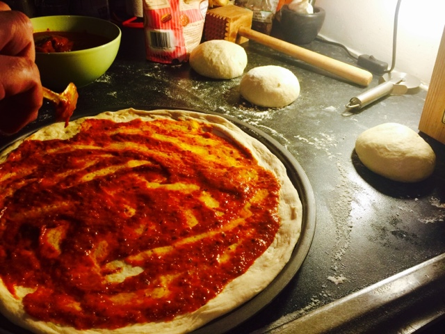 Thin crust pizza with homemade tomato sauce with fresh herbs