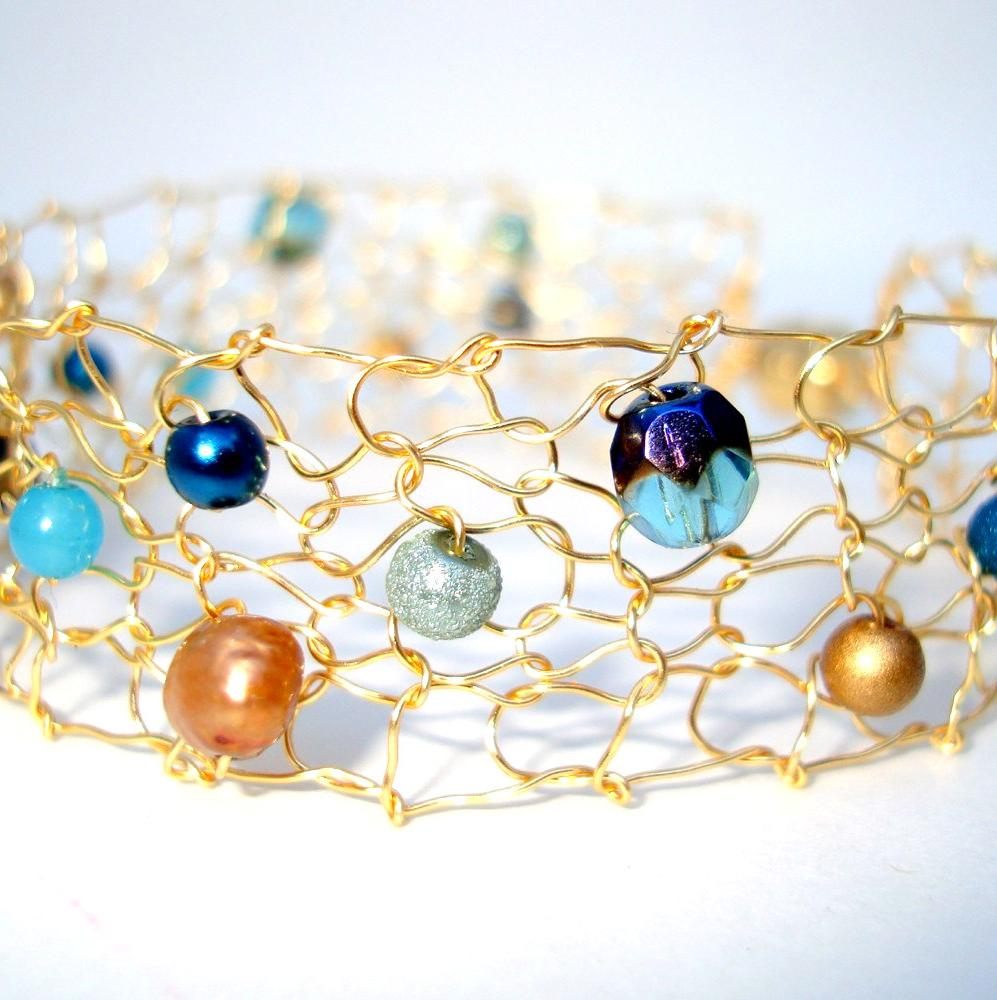 Peacock pearl cuff bracelet, artistic wire knit, aqua, navy, gold,
