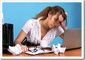 Tired business woman looking at laptop