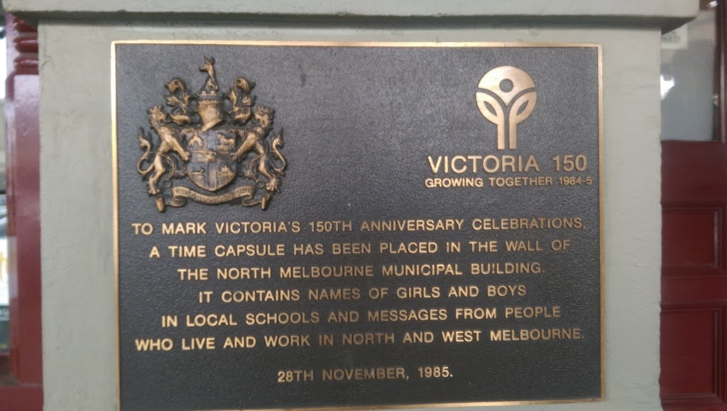 Plaque is on the former North Melbourne Town Hall, it includes the City of Melbourne Coat of Arms and the logo for the 150th Anniversary of Victoria. The plaque reads: TO MARK VICTORIA'S 150TH ...
