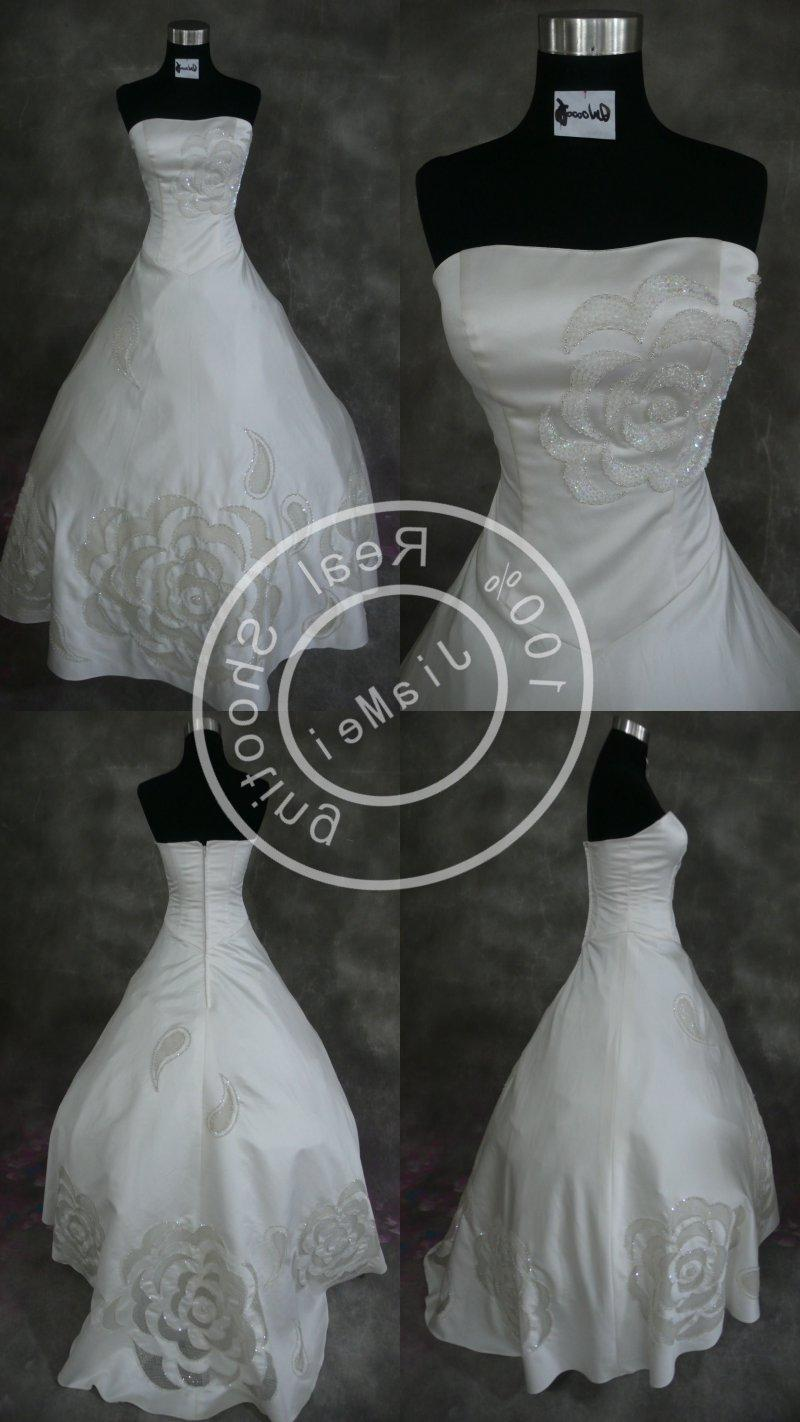 See larger image: Wedding dress Lace bead hollow out mesh bridal gown