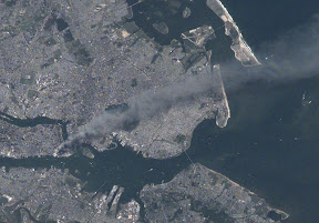 A zoomed in view of the World Trade Center site as seen by astronauts on board the International Space Station on September 11, 2001.  (NASA)  Click the image for a larger view.