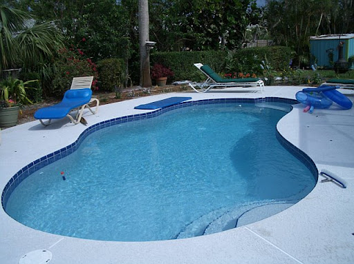 Pool with safety fence down, back yard is also fenced. shed in back was used for garden tools, mower, trimer, etc