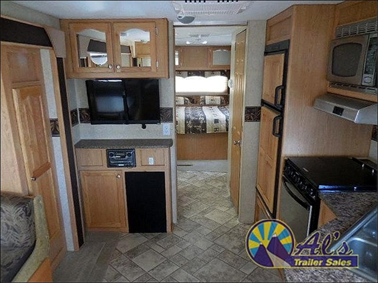 Ad Photo - Entertainment Center and Kitchen