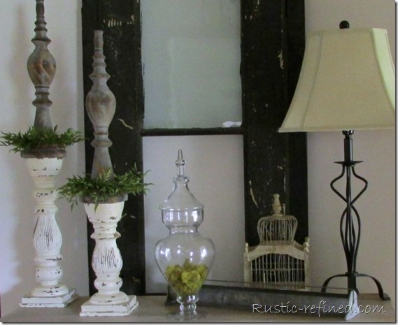 Using a mixture of antiques and galvanized pieces really adds drama to a small entry.