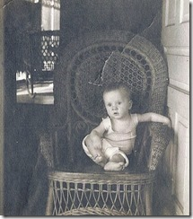 Dad at 5 months sitting on a wicker chair_about May 1913