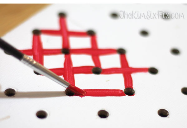 Painted x on pegboard