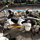 Kevin Magnussen makes a pit stop