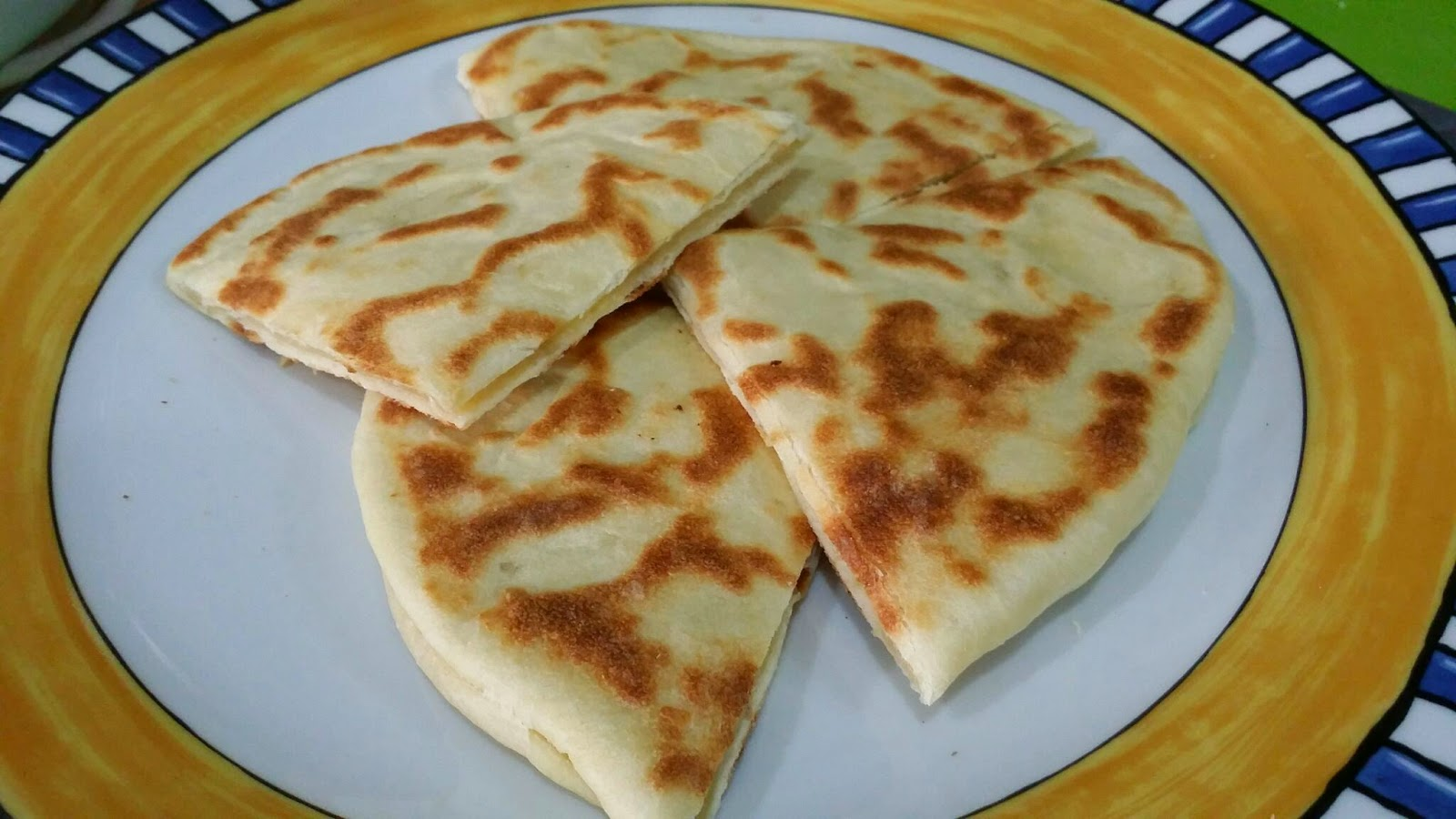 Zulfaza loves cooking roti cheese naan for Ah roy thai cuisine
