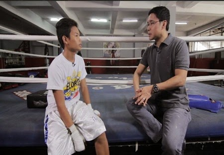 Anthony Taberna with a 15-year-old fan of Manny Pacquiao in Tapatan ni Tunying