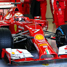 Kimi Raikkonen drives his Ferrari F14 T on to the circuit