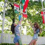 Piwi reaching for the Mexican flag in Vaughan, Ontario, Canada