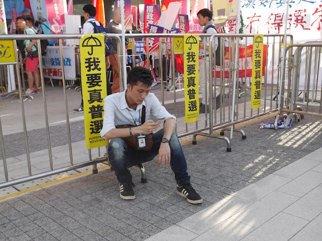 man with media badge using his mobile phone