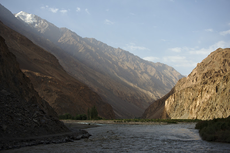 Riding on the along the Bartang river, as the valley gradually becomes wider and more tamed.