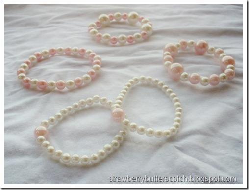 five faux pearl bracelets
