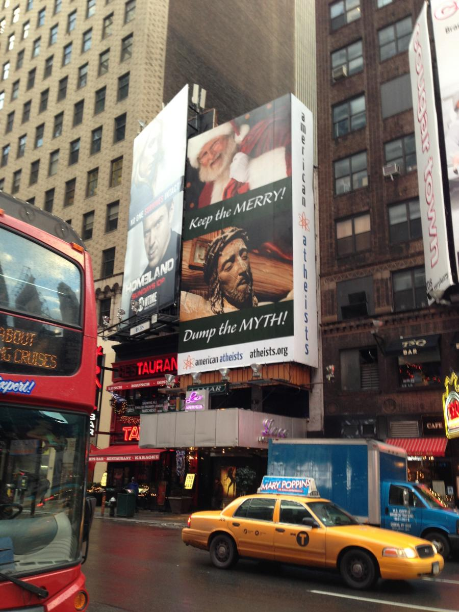 """Keep the Merry! Dump the Myth"" Controversial Billboard In Times Square"