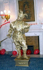 Gold Jester with a horn statue