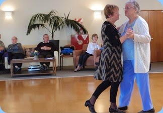 Diane Lyons and a resident, Audrey, dancing to the lovely music. Audrey told me that many years ago she was the lead singer for the famous Joe Loss Orchestra in Briatain! Photo courtesy of Dennis Lyons.