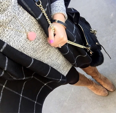 poncho, tan riding boots, rebecca minkoff bag