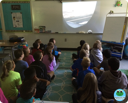 Students in pretend plane for virtual field trip- Luckeyfrog Learning
