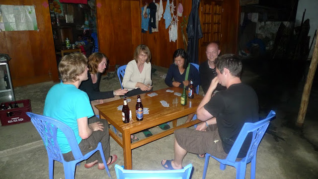An evening game of cards + rice wine + beer = fun!