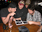 The bar owners show us their photo album of all the girls who've ever shown their ta-ta's for the camera