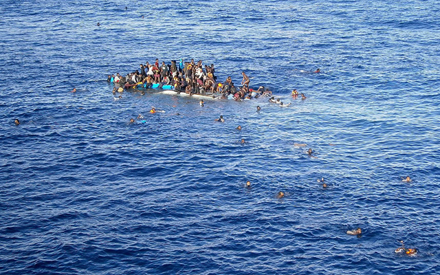 A boat with refugees sinks close to the cargo ship 'OOC Jaguar' in the Mediterranean sea on 12 April 2015. Many of the ships that the desperate refugees flee Africa aboard are very unseaworthy. Photo: EPA / Opielok Offshore Carriers