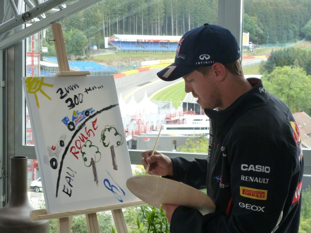 vettel_painting_gift_to_schumacher_300th_race_bel12.jpg