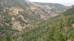 A panoramic view of Cheyenne Canyon - the road up is nestled at the base of the valley.
