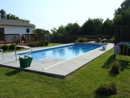Pool has automatic cover & cleaning system