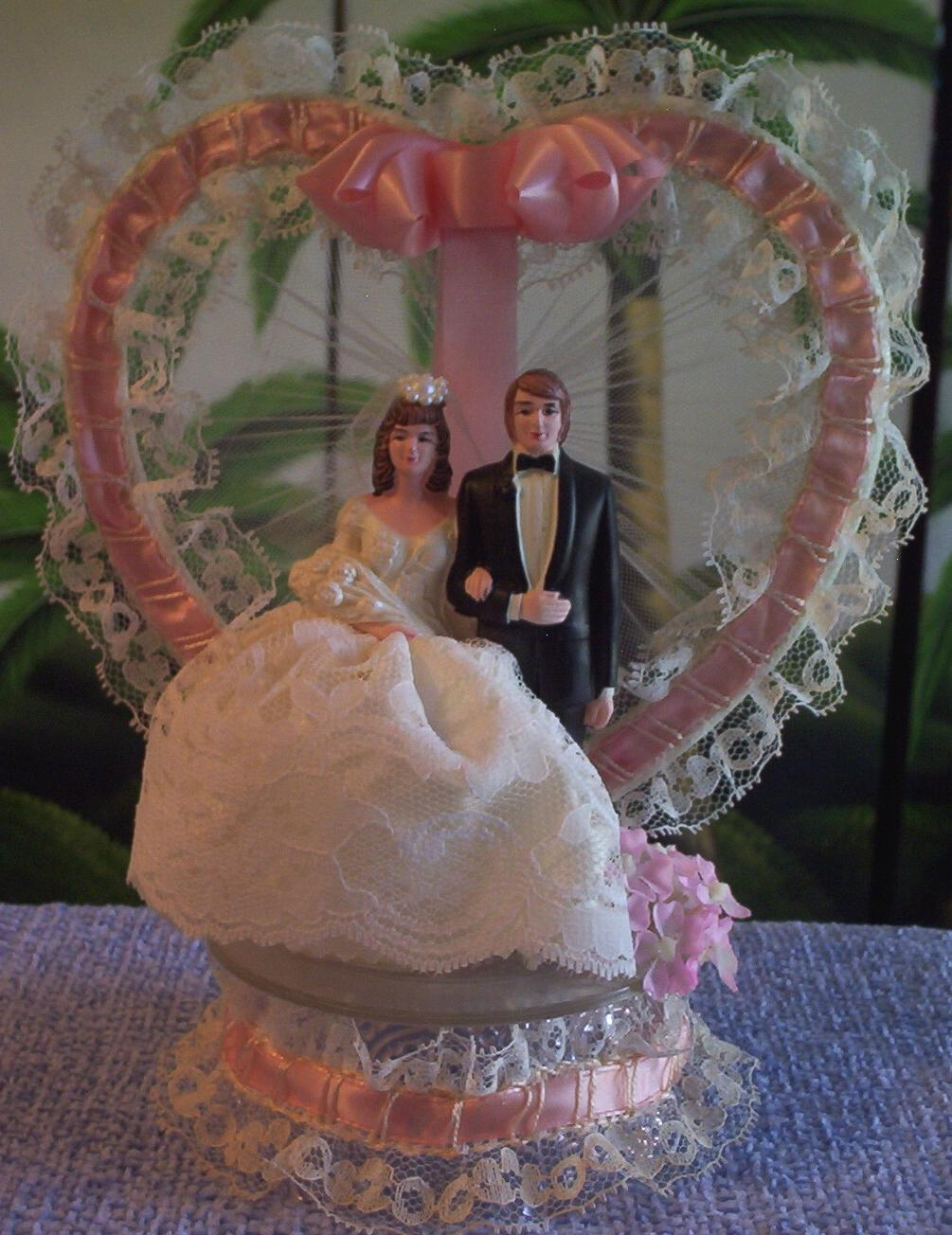 After finding not one, but TWO, vintage wedding cake toppers this week