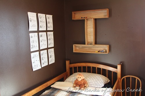 Little boy's room with dark walls