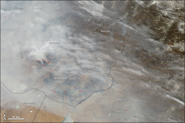Several smoky fires burned in Zabaikalsky Territory on 14 April 2015, when the Moderate Resolution Imaging Spectroradiometer (MODIS) on NASA's Terra satellite acquired this image. The fires are outlined in red. Several dark burn scars are visible through the smoke. Photo: Jeff Schmaltz / LANCE/EOSDIS MODIS Rapid Response Team at NASA GSFC