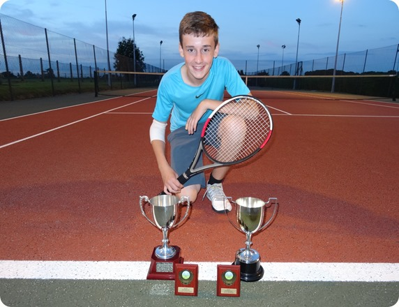 George Raiswell with his Junior Singles and Mens Doubles  trophies