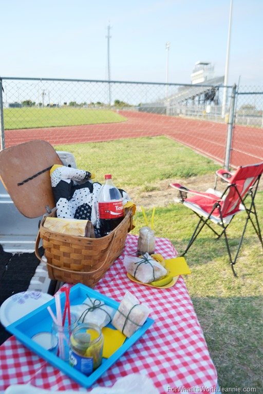 tailgate meal set up by football field