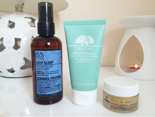 The Body Shop Deep Sleep Pillow Spray, NUXE reve de miel lip balm, Origins make a difference hand cream