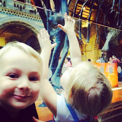 Blake and Maegan with Dippy the diplodocus at the natural history museum