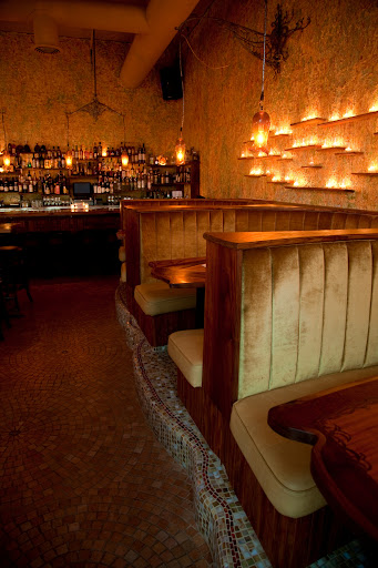 Booths and bar at Toulouse Petit photo: Lara FeroniCQ