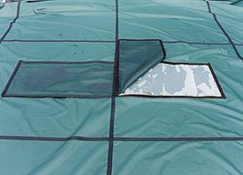 Certified-Safe Solid Safety Cover with sane mesh panel.<br />Propools.com Certified-Safe Safety Covers are available for Concrete or Wood Decking. <br />Click to get yours today http://www.propools.com/In_Ground_Pools-Winter_Cover-Safety.php<br />Available for most any shape or size. Custom Covers and Re-Makes are no problem.