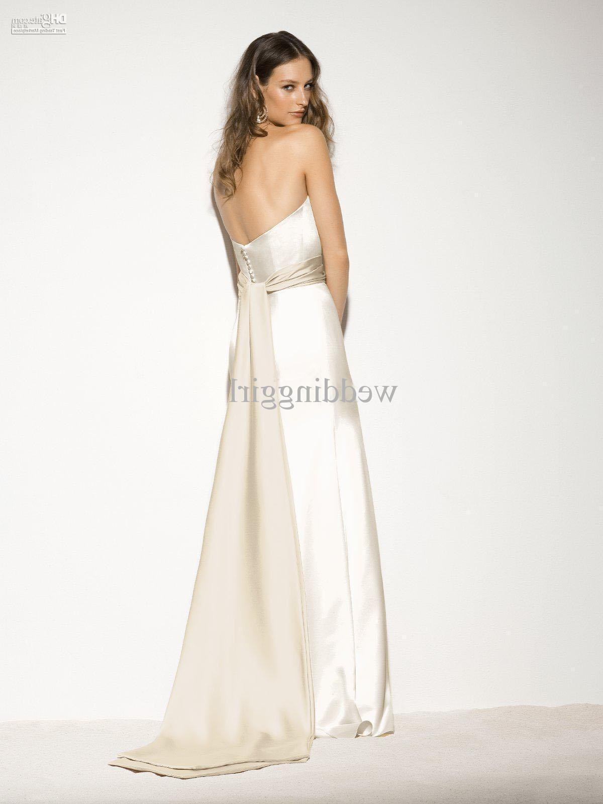 V-neck mermaid slhouette lace gown with satin bow and jeweled detail on