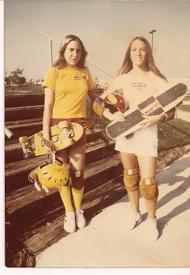 "Laura Thornhill & Robin Logan holding their own ""signature"" model boards"