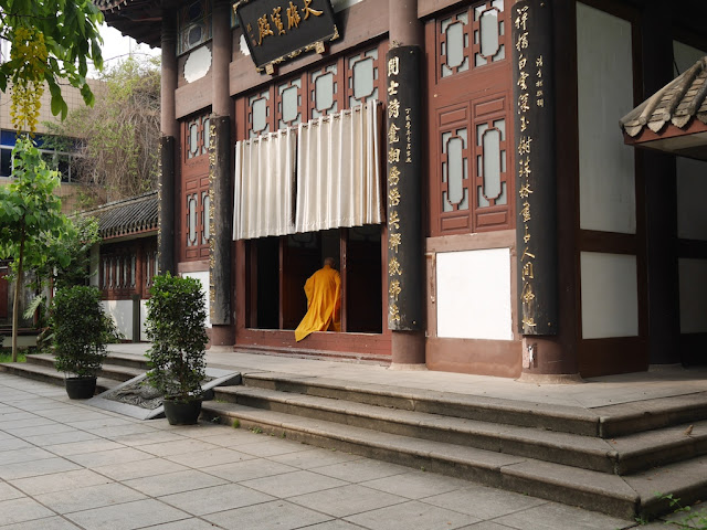 monk walking into a prayer hall at Kaihua Temple in Fuzhou