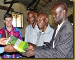 Giving theology book to Muena Ditu