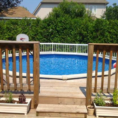 Above ground pool.  Part of the deck is 20 x 16 then attached to a step up deck that wraps around half of the pool dimensions approx 20 x 10.  This area is perfect for watching the kids swim.  There is a gate on the upper deck that closes and locks for safety.  There are two set of stairs off of the main deck, one out to the garden and one out to the grassy part of the yard and garage access.  The yard is fenced on three sides and completely surrounded by a large private cedar hedge. There are garden beds ready for your green thumb!