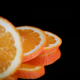 Slices by Suzana Trifkovic - Food & Drink Fruits & Vegetables ( orange, nutrition, fruit, reflection, food, healthy )