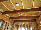 All beams re-coated w/ varnish in prep for drywall. 3/23/15