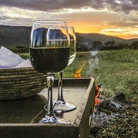 Drinks at Sunset by Richard Michael Lingo - Food & Drink Alcohol & Drinks ( wine, sunset, alcohol, drink, cheese, africa, fire )