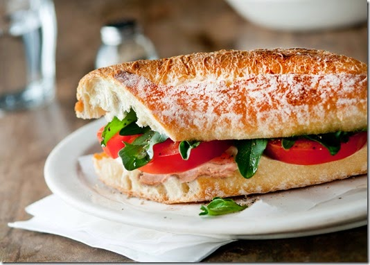 baguette sandwich with mozzarella, tomatoes and arugula