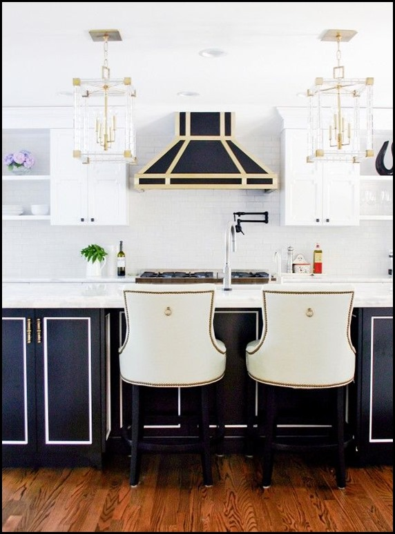 black and white kitchen with brass
